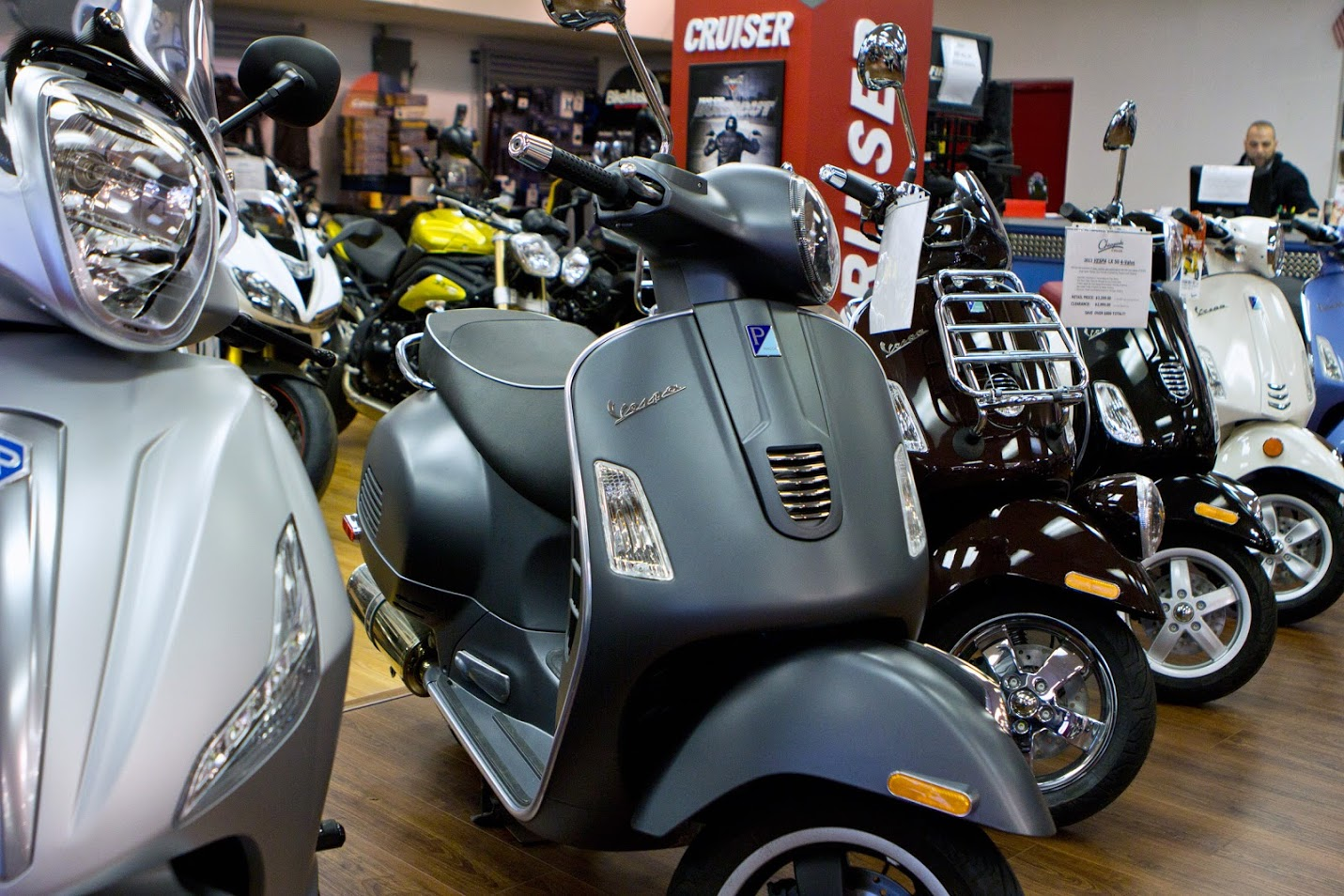vespa scooters in shop